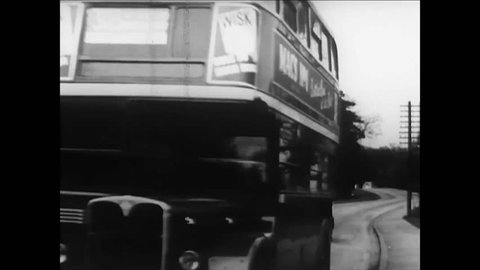 CIRCA 1950s - Two African students in the countryside outside London go to the bus station in the 1950s.