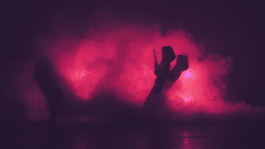 Silhouette of woman in smoke