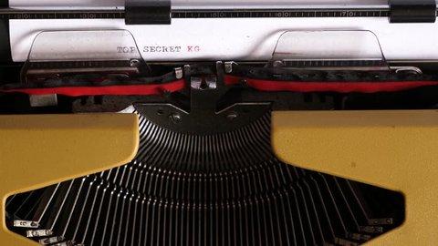 """Typing """"TOP SECRET KGB"""" on an old typewriter"""