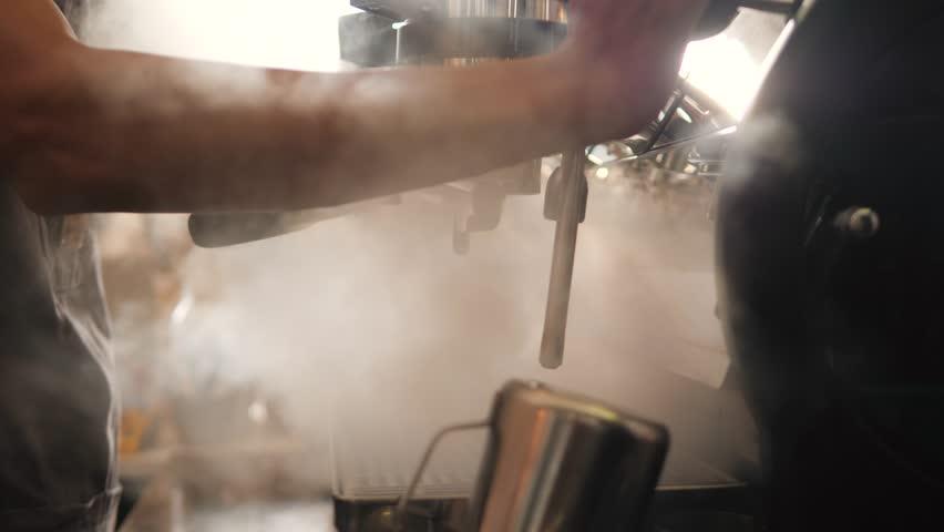 Blast of Steam on Professonal Coffee Machine. Barista Working in Coffeeshop. 4K, Slowmotion.