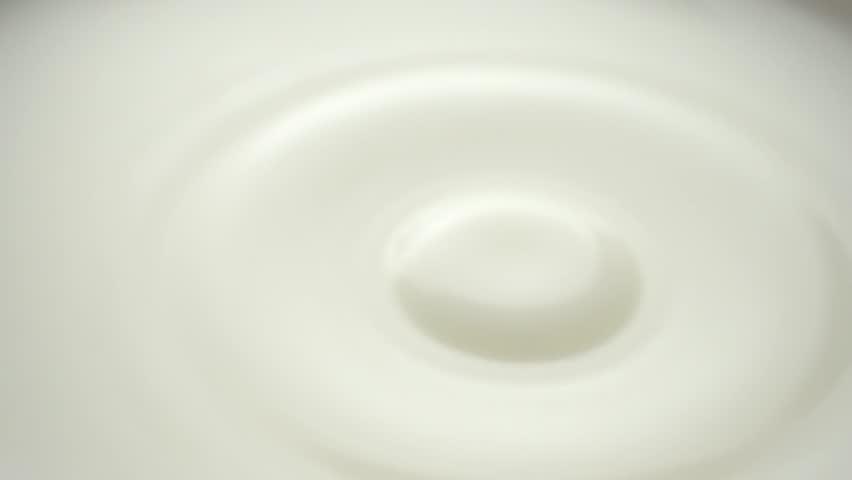 milk dropping and splashing in slow motion