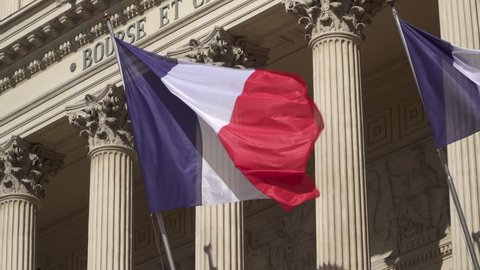 Blowing french flags at Chamber of Commerce in Marseille