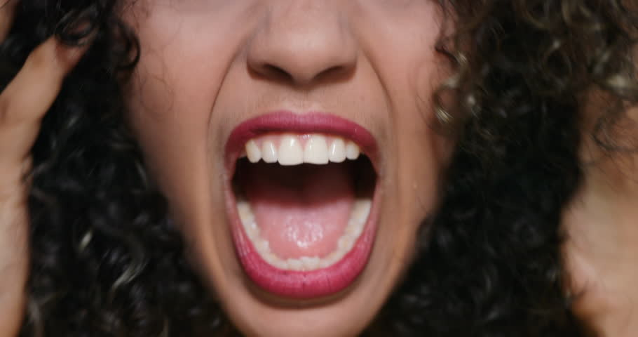 Closeup of angry woman. African American girl showing fear, terror and frustration. Slow motion | Shutterstock HD Video #1009339652