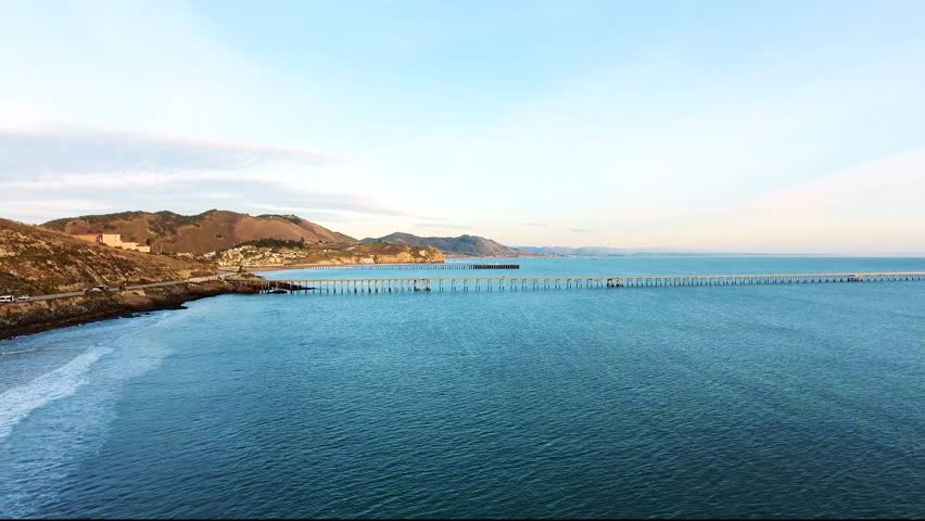 Aerial Flyover - Avila Beach seaside town drone view with a pier and mountains | Shutterstock HD Video #1009346012