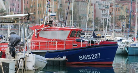Menton, France - March 31, 2018: Boat Rescuers At Sea (Les Sauveteurs En Mer in French) Moored on The Harbor of Menton Garavan, France. SNSM is a French Voluntary Organisation Founded in 1967 - DCi 4K