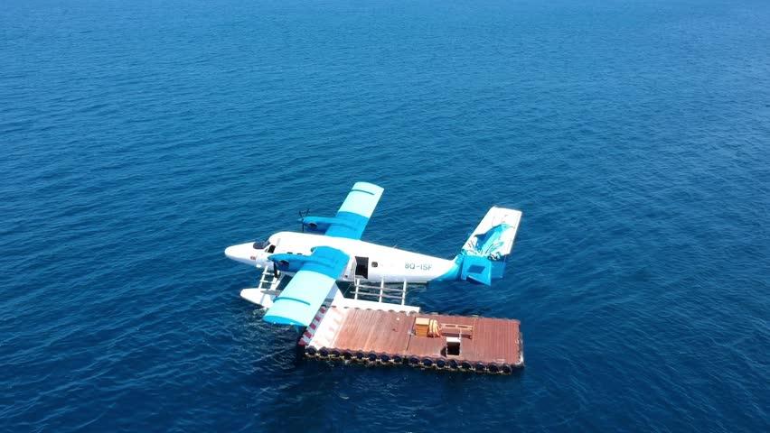 Kudafushi, Maldives - October 24th 2017 - Top view of a Seaplane at coal in paradise