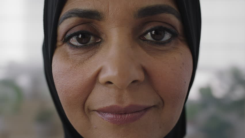 close up portrait of senior muslim woman looking pensive calm at camera experienced middle aged female wearing tradition headscarf real people series