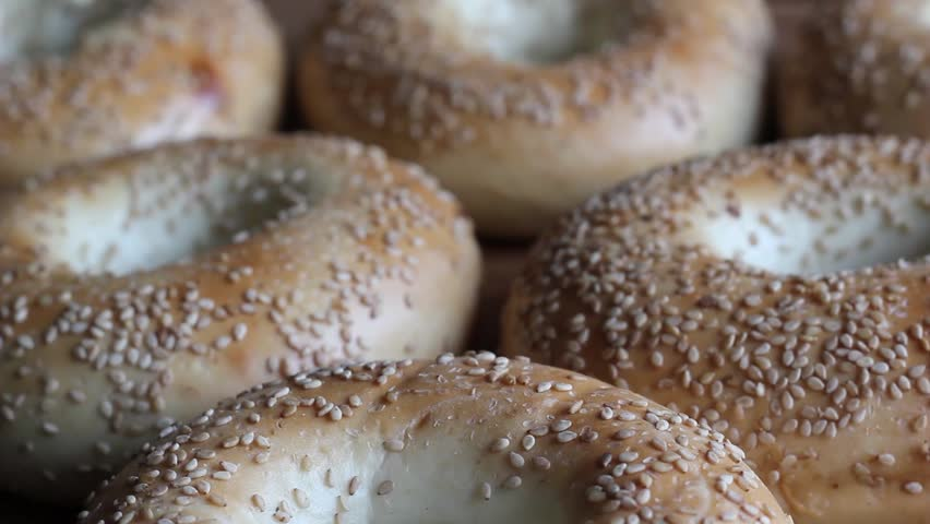 Fresh bagels with sesame seeds isolated. HD video.