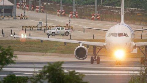 PHUKET, THAILAND - DECEMBER 2, 2016: Bangkok Air Airbus 320 HS-PPJ turn runway before departure at Phuket airport. Rainy weather