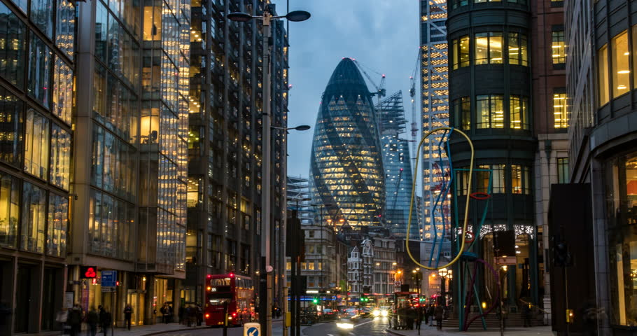 Timelapse view of a busy crossroad at a traffic light in the hearth of the financial district of the City of London | Shutterstock HD Video #1009598552