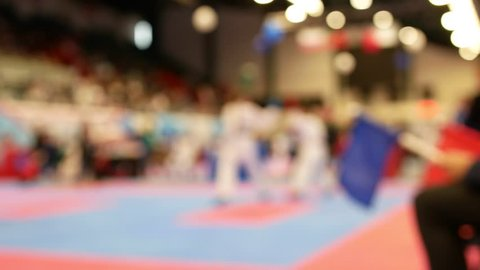 Two teenagers fighting at the karate championship - blurred