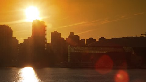 Time Lapse of the sun setting behind downtown Vancouver.