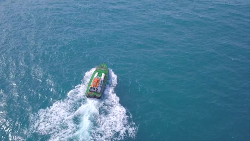 Aerial footage- Following a Pilot boat at sea