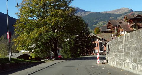 Grindelwald, Cinema 4k pov view driving in grindelwald town, on a sunny autumn day, in berner oberland, of the swiss alps of Switzerland