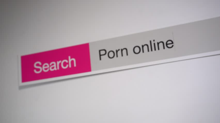 Porn online - browser search query online, typing in the search term into Internet. Search web form, tablet screen shot close up.