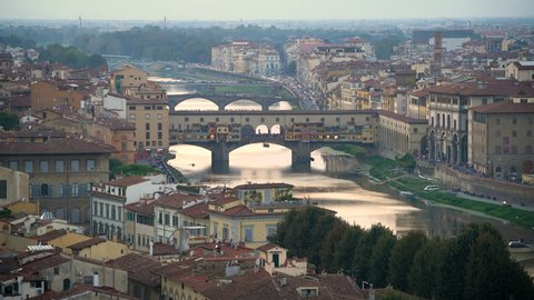 Florence Ponte Vecchio Bridge and City Skyline in Italy. Florence is capital city of the Italian region Tuscany. Florence was center of Italy medieval trade and wealthiest cities of era.