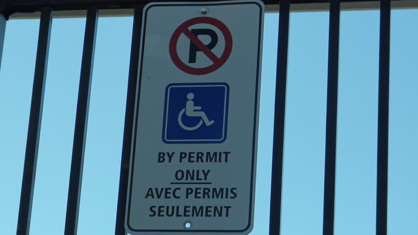 Parking For Disabled Only (handicapped symbol) in English and French language