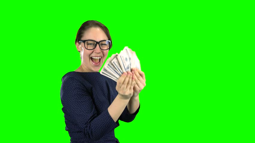 Accountant holds paper money in his hands and considers them. Green screen. Side view | Shutterstock HD Video #1009713812