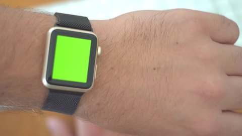 Checking Digital Apple Watch While Working - Green Screen