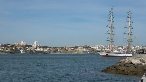 Beautiful  sailing vessel tallship entering a harbor in Portugal