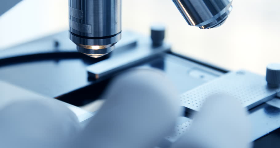 Close up shot of the scientist studies examining of test sample under the microscope in laboratory. #1009729532