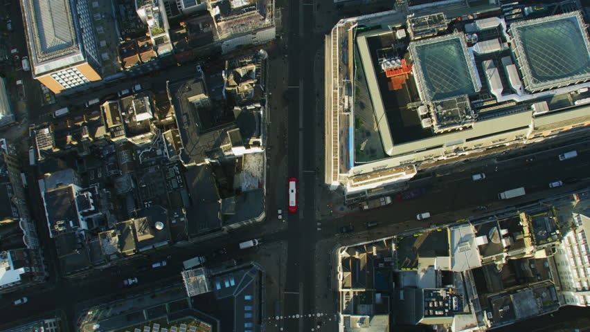 Aerial overhead view sunrise over Oxford Street commercial and retail rooftops public transport commuter vehicles London England UK RED WEAPON | Shutterstock HD Video #1009745822