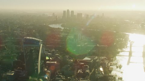 Aerial sunrise view from Walkie Talkie building along River Thames Tower Bridge to Canary Wharf London England UK RED WEAPON