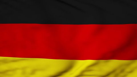 The German flag waving in the wind. The Germany flag flaps in the breeze, filling the whole frame.