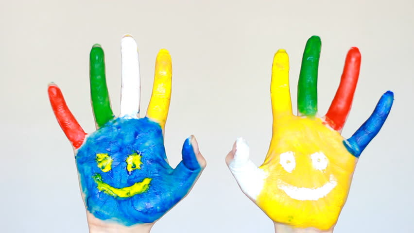 Art and painting. Dirty hands painted multicolored with smiles. The concept of happiness, good mood, joy, creative | Shutterstock HD Video #1009823882