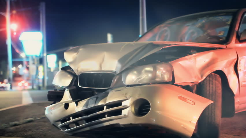 Smashed vehicle on side of road, car accident background loop
