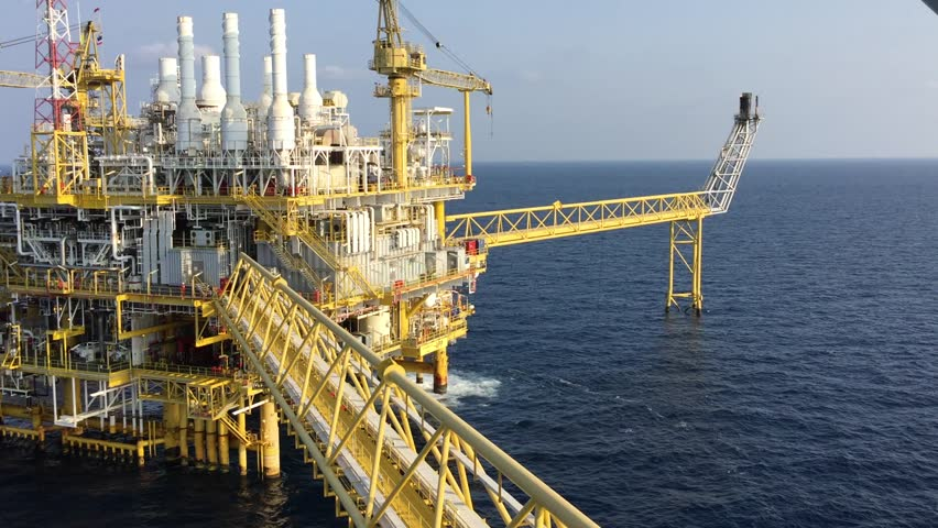 Helicopter landing at offshore oil and gas accommodation platform the background is central processing platform.  Offshore transportaion and logistic services.