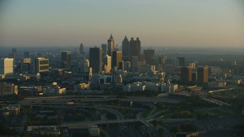 Atlanta - November 2017: Aerial view at dawn sunrise of city haze skyscrapers Mercedes Benz Stadium home to the Atlanta Falcons National Football League Southern States USA