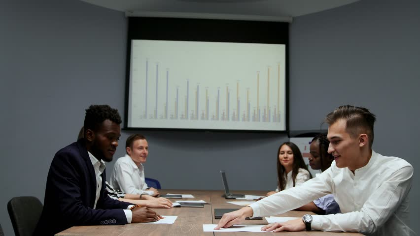Conclusion multietnicita mutually beneficial transactions between African American and European. Transfer of ownership in the conference room. The Board of Directors. Business meeting.   Shutterstock HD Video #1009936082