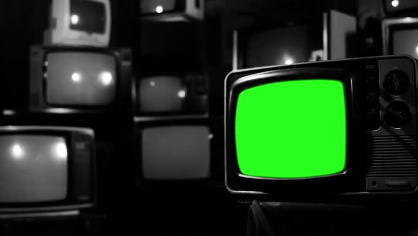Vintage 80s Tv with Green Screen. Black and White Tone. Zoom Out. Ready to replace green screen with any footage or picture you want.  | Shutterstock HD Video #1009948262