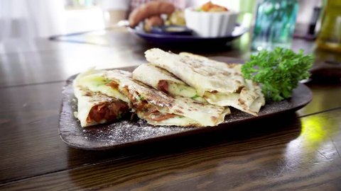 Mexican vegetarian quesadilla with cheese, tomatoes and eggplant