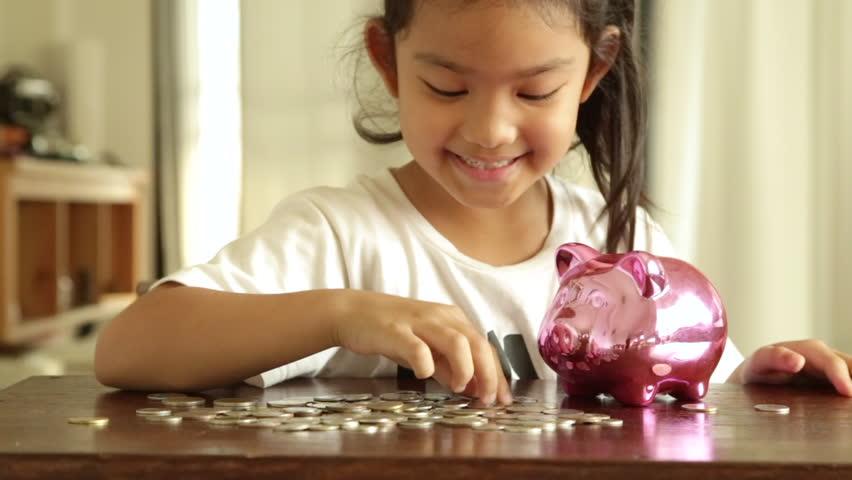Asian girl with saving money, Deposit concept | Shutterstock HD Video #1009960112