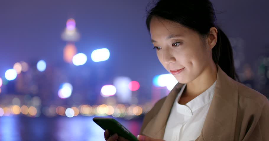 Business woman use of mobile phone at night   Shutterstock HD Video #1009966502