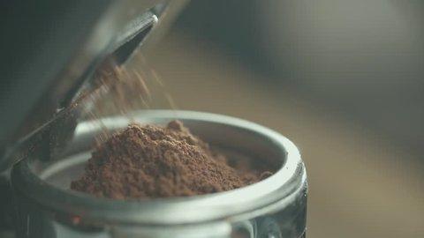 close-up, slow motion, coffee machine holder fill up flickered coffee espresso machine