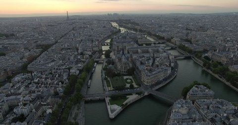 PARIS, FRANCE – SEPTEMBER 2016 : Aerial shot over central Paris island at sunset with view of Notre Dame, Eiffel Tower and river Seine