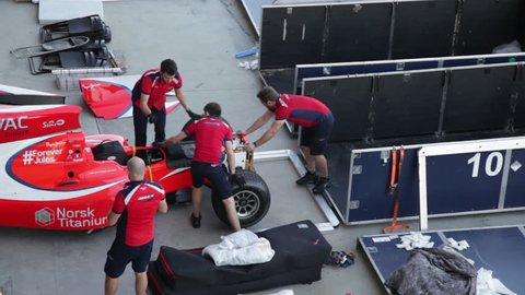 Shakir, Bahrain. CIRCA December 2015: Bahrain International Circuit - World Endurance Championship 2015. Mechanics and technicians working.