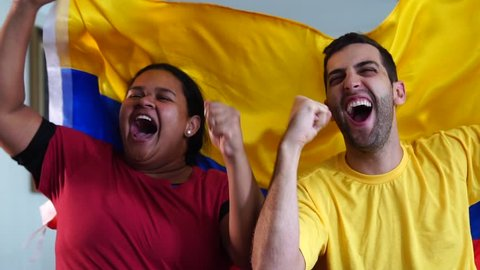 Colombian Friends Celebrating with National Flag