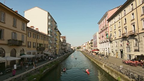 Navigli canal in Milan, Italy. Rowing and relaxing on a sunny summer afternoon.