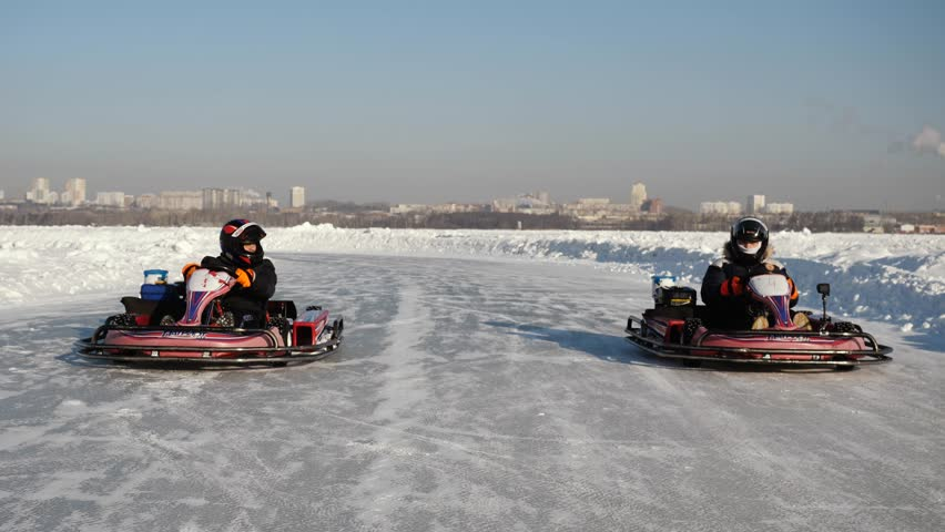 Opening of the Winter Season - Free open auto show - winter carting on the snow track. Karting in the winter