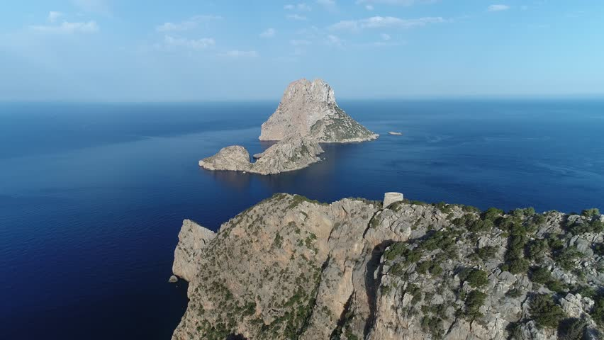 The iconic ibiza mystical island of Es Vedra surrounded by deep blue sea