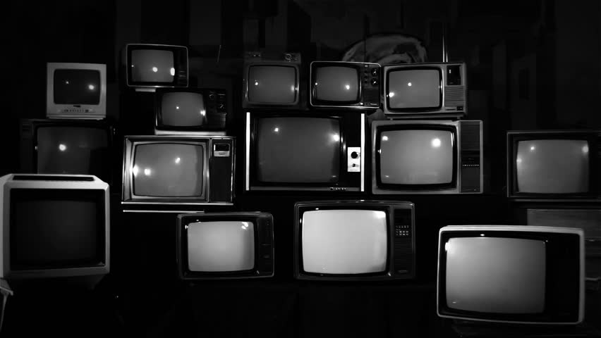 """Stack of Retro TVs turning on Green Screens. BW Tone. Zoom In. You can Replace Green Screen with the Footage you Want with """"Keying"""" effect in After Effects (check out tutorials on YouTube).   Shutterstock HD Video #1010055422"""