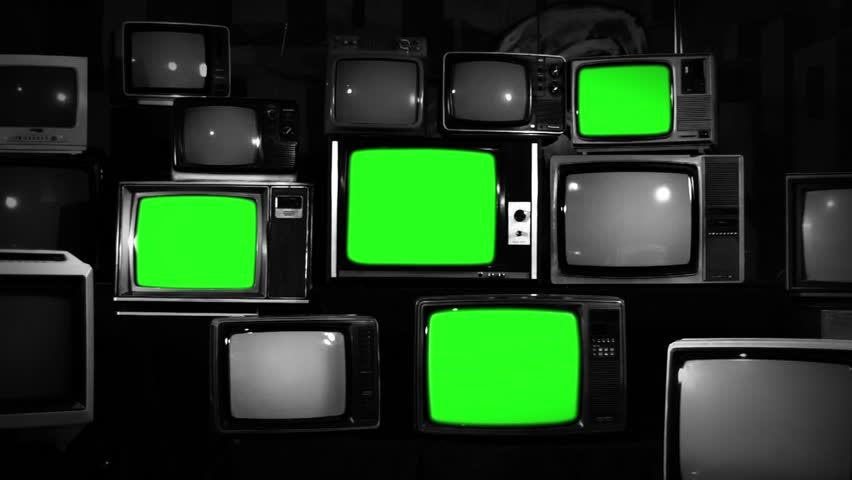 "Stack of Retro TVs turning on Green Screens. BW Tone. Zoom In. You can Replace Green Screen with the Footage you Want with ""Keying"" effect in After Effects (check out tutorials on YouTube). 