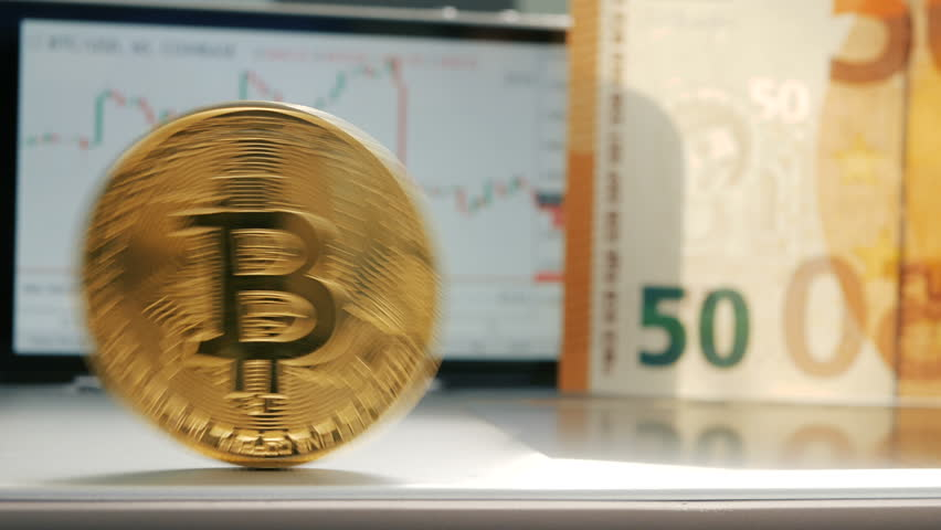 Golden bitcoin BTC fluttering on the background of a graphic stock chart | Shutterstock HD Video #1010059622