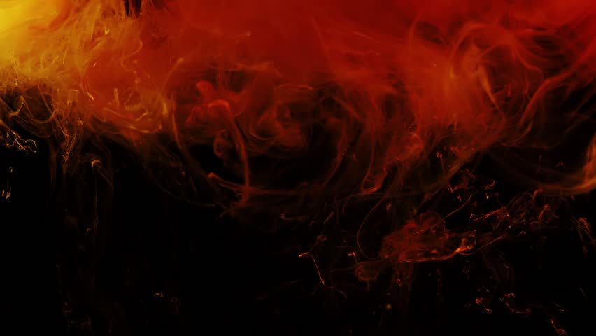 Yellow and red dense clouds of smoke rise up against black background. Abstraction of fire. Magic and mystical background with  liquid fire substance. slow motion. Energy of Fire.