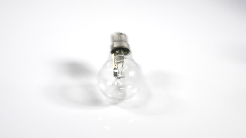 4K Light bulb rolling on white surface background, moving object, energy efficient tungsten lamp | Shutterstock HD Video #1010071742