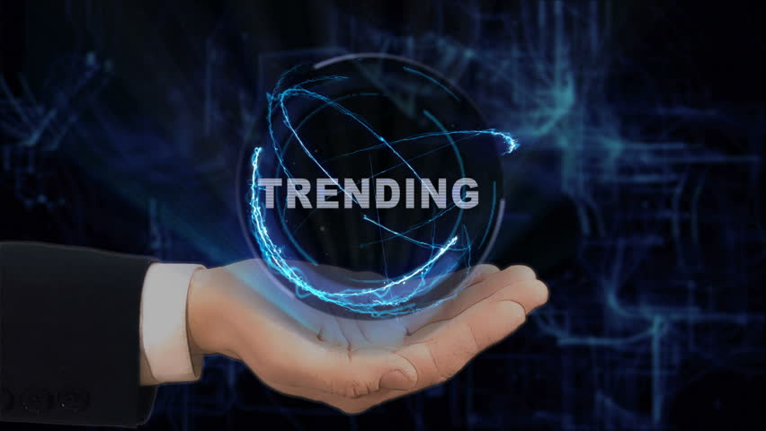 Painted hand shows concept hologram Trending on his hand. Drawn man in business suit with future technology screen and modern cosmic background   Shutterstock HD Video #1010101742